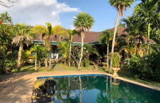 Pool villa with a large pool deck overlooking a huge garden for sale